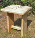 small wooden garden table with tealights